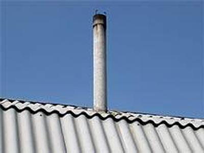 Асбестовая труба на крыше